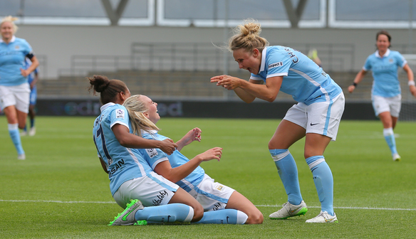 MANCHESTER, ENGLAND - JULY 12:  Toni Duggan of Manchester City celebrates with Nikita Parris (L) and Isobel Christiansen after scoring against Birmingham City during the Women's Super League match between Manchester City and Birmingham at the Manchester City Academy Stadium on July 12, 2015 in Manchester, England. (Photo by Dave Thompson - The FA via Getty Images)
